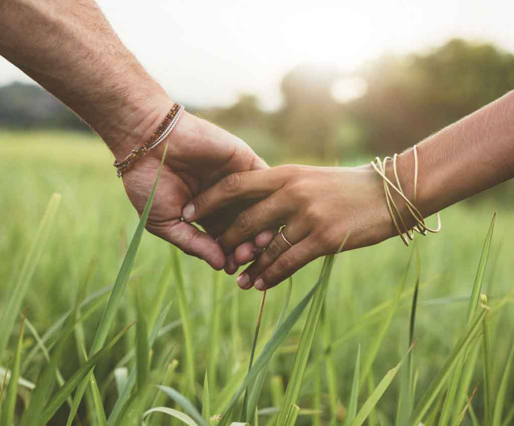 About DU'IT image showcasing 'Green', natural attributes, with couple holding hands emphasising core value of 'togetherness'